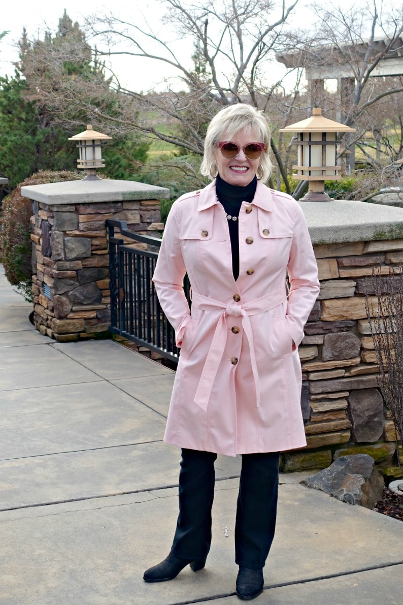 Jennifer Connolly of A Well Styled Life wearing Talbots Modern Trench over black turtleneck, black jeans and black booties.