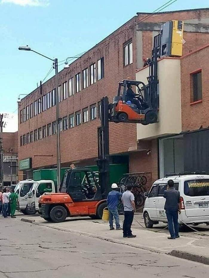 forklift-lifting-another-audacious-workers