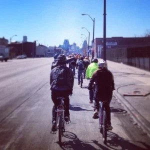 Slow Rollers cruise down Gratiot on a sunny afternoon in Detroit.