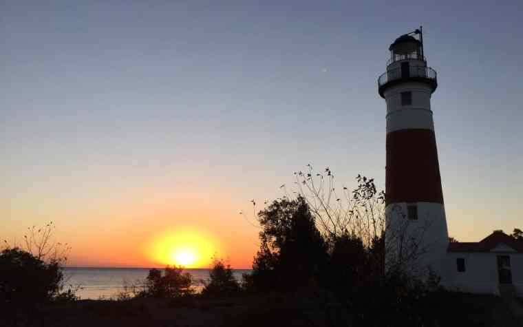 Sunrise over Lake Huron from Middle Island Lighthouse. Photo by Joel Heckaman - Awesome Mitten #MittenTrip
