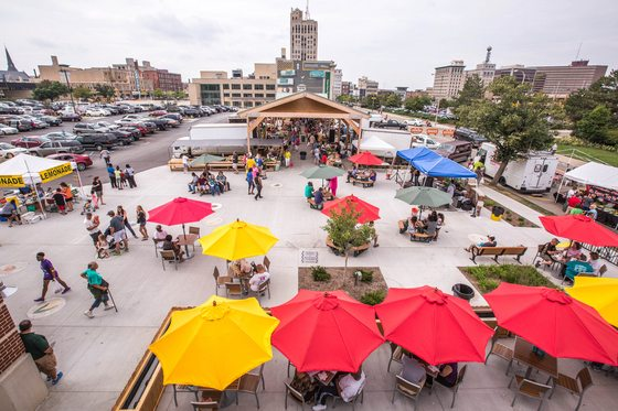 Catch up with friends, book an event, or just get away for a minute on the new Rooftop Terrace at the Flint Farmer's Market. Photo courtesy of Michigan Homes