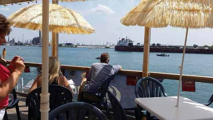 Watch everything from jet skis to freighters passing by on the beautiful St. Clair River from the patio at Rix's on the Rocks in Port Huron. Photo courtesy of Merchant Circle