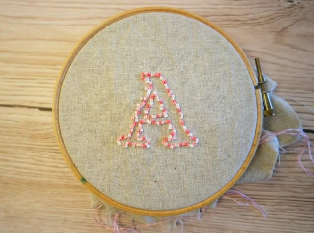 negative space embroidery clasp purse