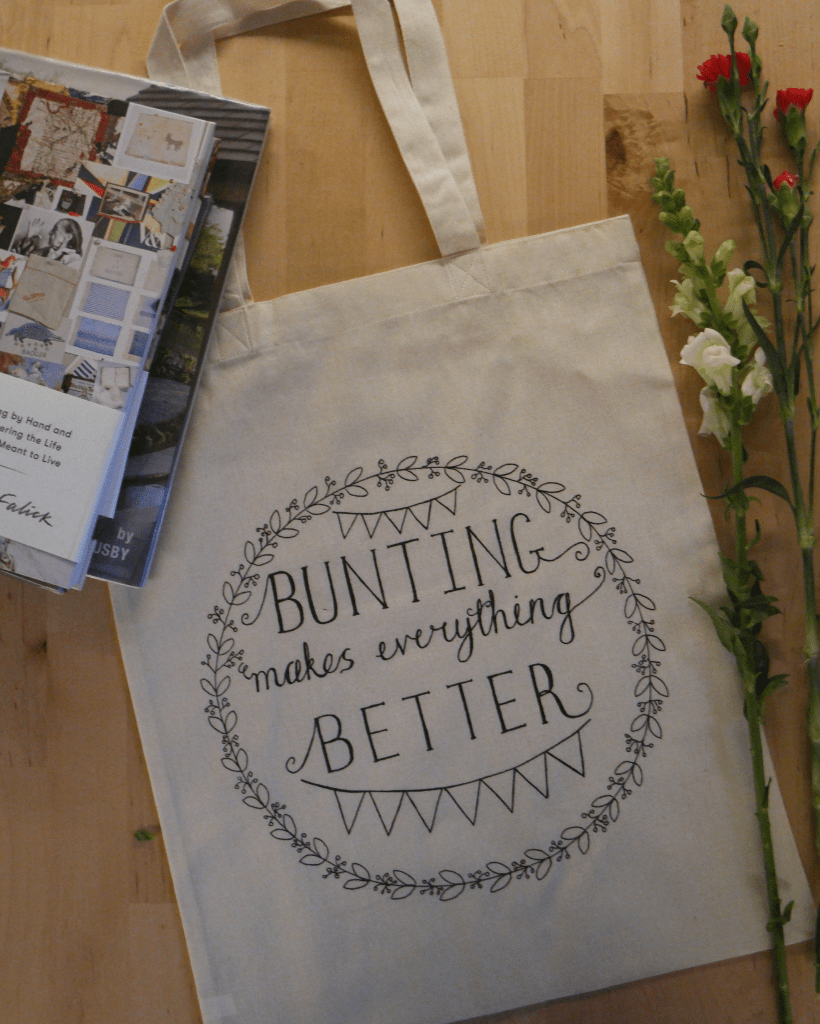 bunting makes everything better tote bag handlettering for embroidery