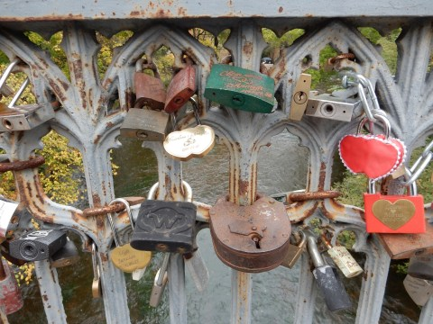 Love locks on the bridge into Uzupis in Vilnius, Lithuania