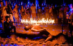 Sunset parties go the nice kind of crazy by the beach in Koh Tao, Thailand.