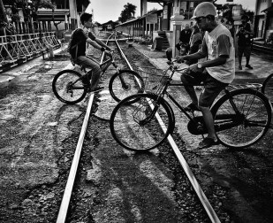 Wandering around #Yogyakarta's streets with #INAtopBucketList @aworldtotravel @juanjerez @myadventuresacrosstheworld yesterday resulted in tons of great shots of the active local community. To give you an idea, we spent almost half an hour on these rails as people, carts and bikes were crossing them non stop. Love this city light! In Yogyakarta.