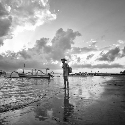Sanur beach local enjoying the 1st sunbeams yesterday in Bali, Indonesia.