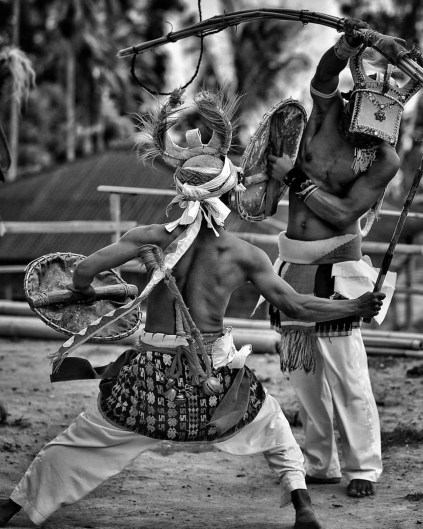 Caci teaditional dancers at Melo Village, Labuan Bajo, Flores.
