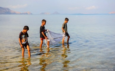 Kids fishing in Labuan Bajo at sunrise