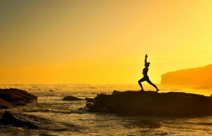 Virabhadrasana - Warrior One Yoga Pose - Cathedrals beach at sunrise - Ribadeo - Galicia - A World to Travel