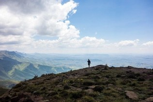 Guide to the Drakensberg Mountains of South Africa - hiker on top of the hill