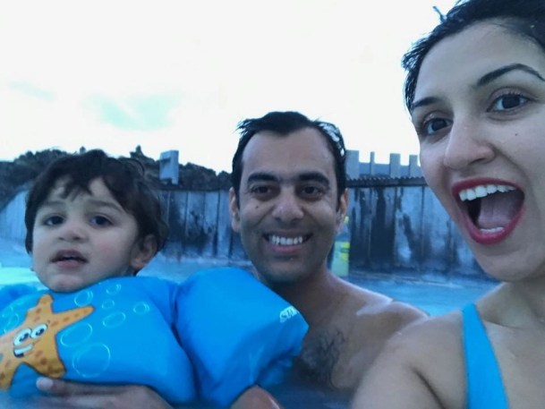 Enjoying time as a family in the Blue Lagoon - Things I Learned After Traveling With An Infant Across The World - A World to Travel