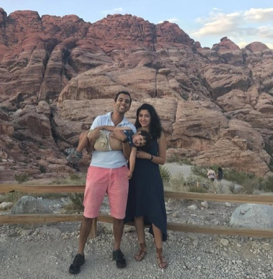 Family pic in front of Red Rock Canyon in Las Vegas - Things I Learned After Traveling With An Infant Across The World - A World to Travel