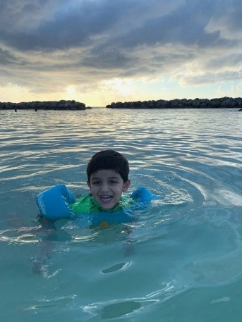 Swimming in a cove in Grand Cayman - Things I Learned After Traveling With An Infant Across The World - A World to Travel
