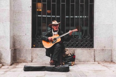 A street performer plays the guitar in front of Teatro Real, Madrid, Spain