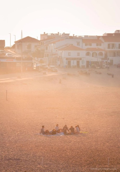 A group of young people sitting in Baleal beach