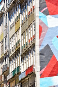 Colorful street art and iconic balconies in Porto city center