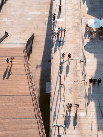 Tiny people and their shades as seen right from above Dom Luís I Bridge in Porto