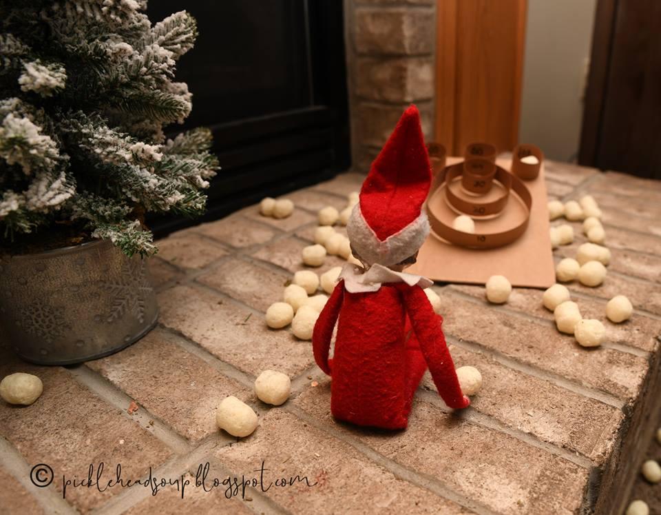 Elf plays skeeball