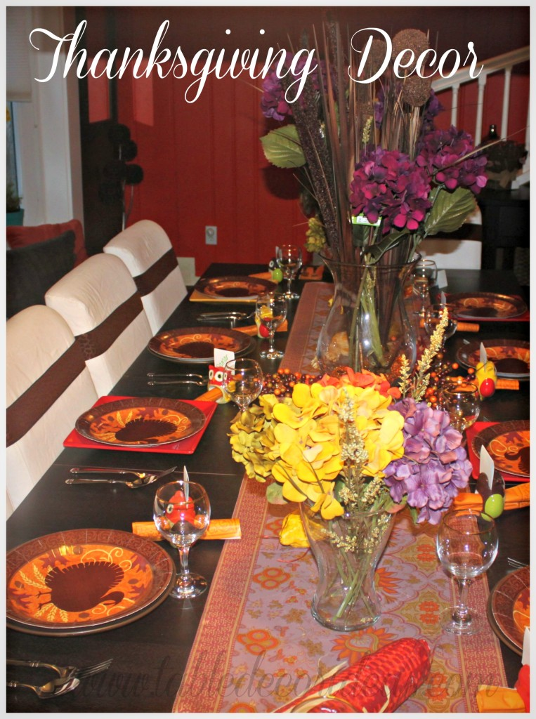 Thanksgiving Table Decor- Spruce up your Thanksgiving Table setting with this beautiful table decor idea filled with purple, brown and orange! It's a frugal idea and very easy to arrange. Pin it and check it out here....