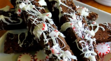 This Peppermint Chocolate Biscotti Recipe is perfect for hoarding sharing with friends and family, or packaged up in a clear cellophane treat bag tucked inside a pretty mug and given as a gift.