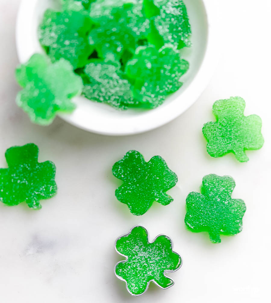 homemade gumdrops in green on a white background