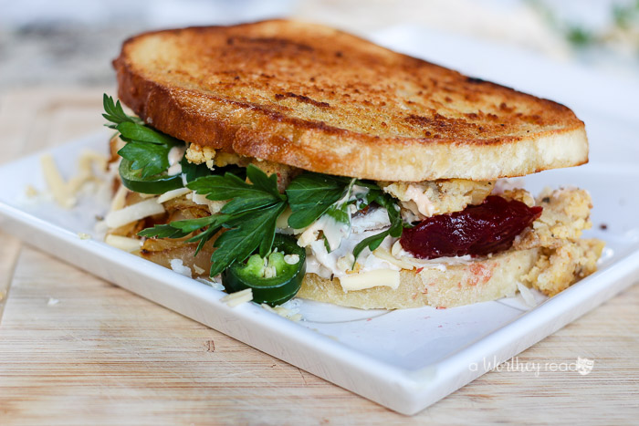 What to do with all of the Thanksgiving leftovers? I have the perfect idea on how to use up your leftover turkey, dressing and more. Try our ultimate turkey thanksgiving sandwich this year- I give you the Spicy Thanksgiving Turkey & Dressing Sandwich.