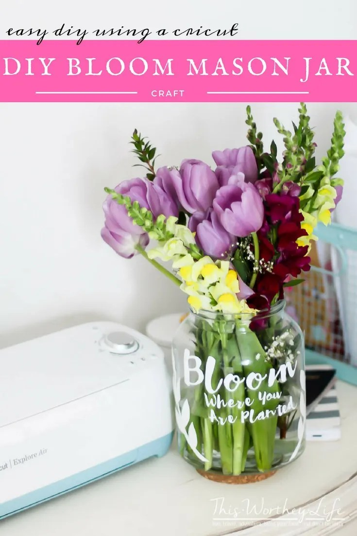 Create your own Bloom Where You Are Planted sign to put on a Mason Jar! This is an easy DIY using a Mason Jar. Add fresh flowers, and this jar is ready to use! Get the directions on the blog!