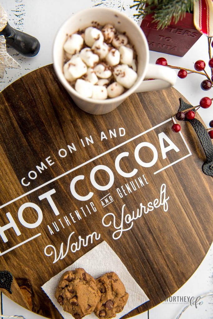This simple but beautiful DIY Wooden Serving Tray is a perfect way to use your Cricut for adding a special message to your new cocoa serving tray. I love simple DIY ideas, and this one is a great choice for the holiday season. It is beautiful but simple, and it is easy enough anyone can make this!