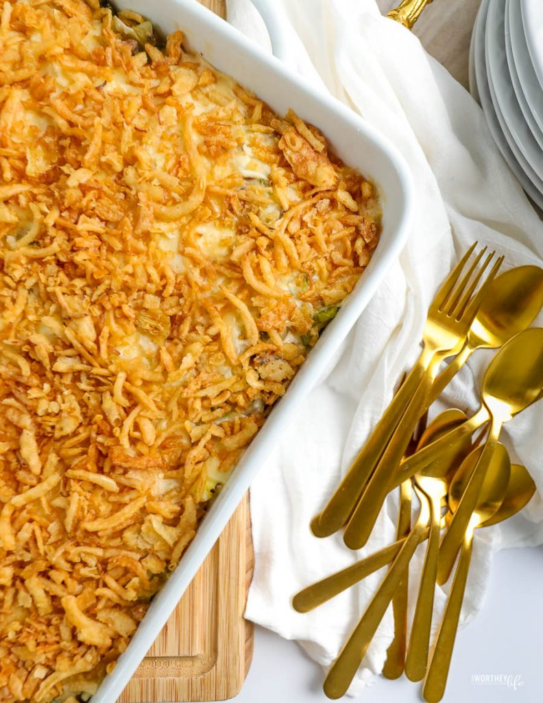 breakfast casserole in a large white dish with gold spoons