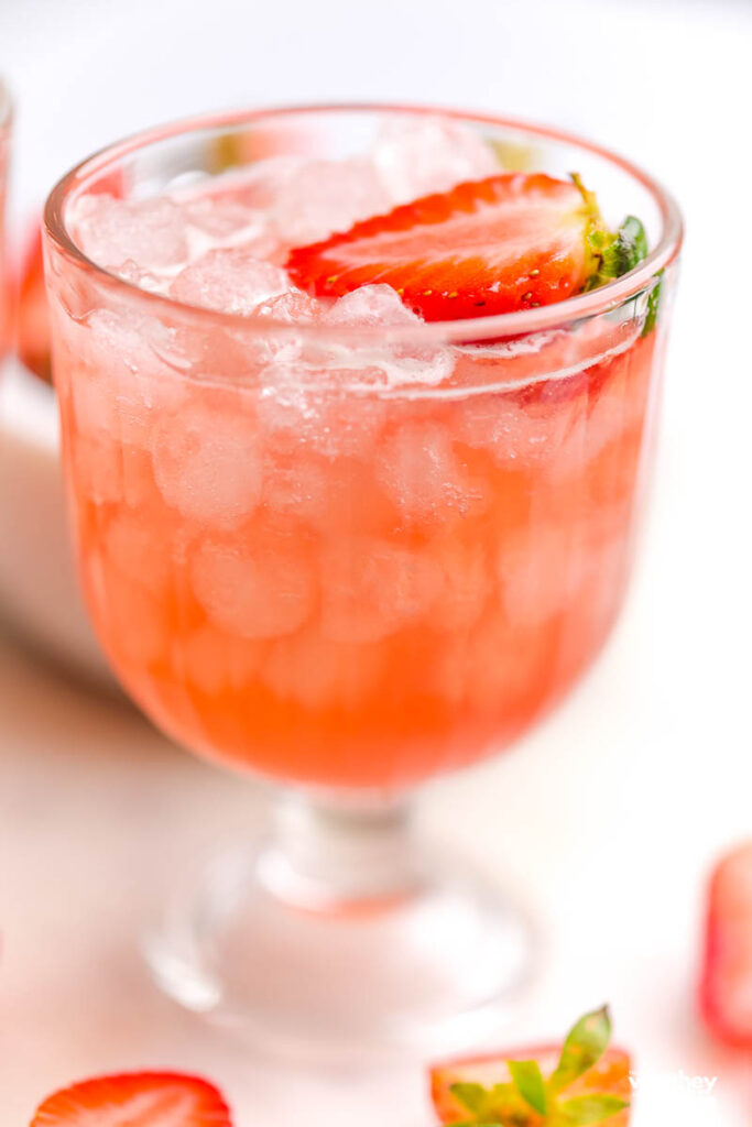 pink mocktail in a tall glass