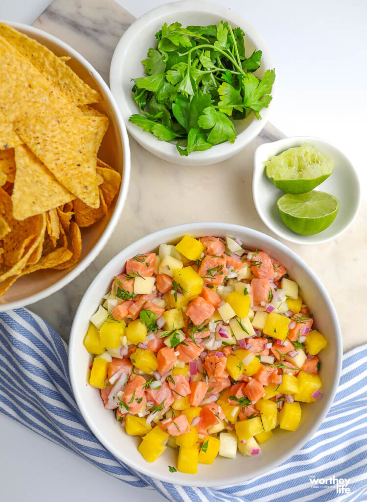 ceviche and corn tortilla chips served with lime and fresh cilantro