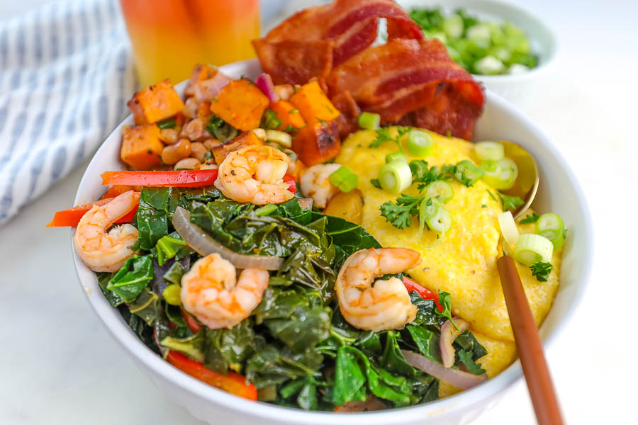 greens, sweet potatoes and shrimp in a white bowl