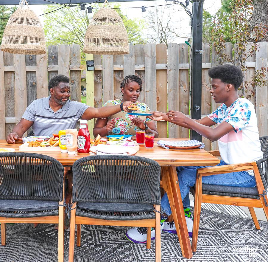 family enjoying burgers