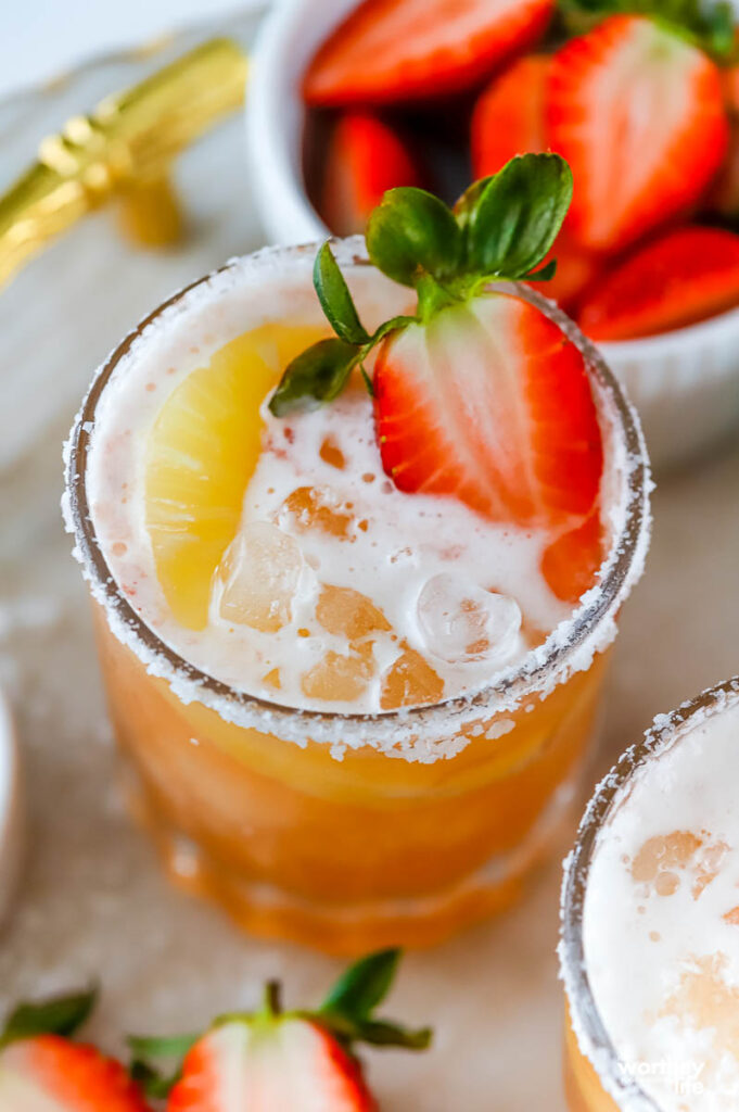 shrub cocktail with pineapple juice and strawberries