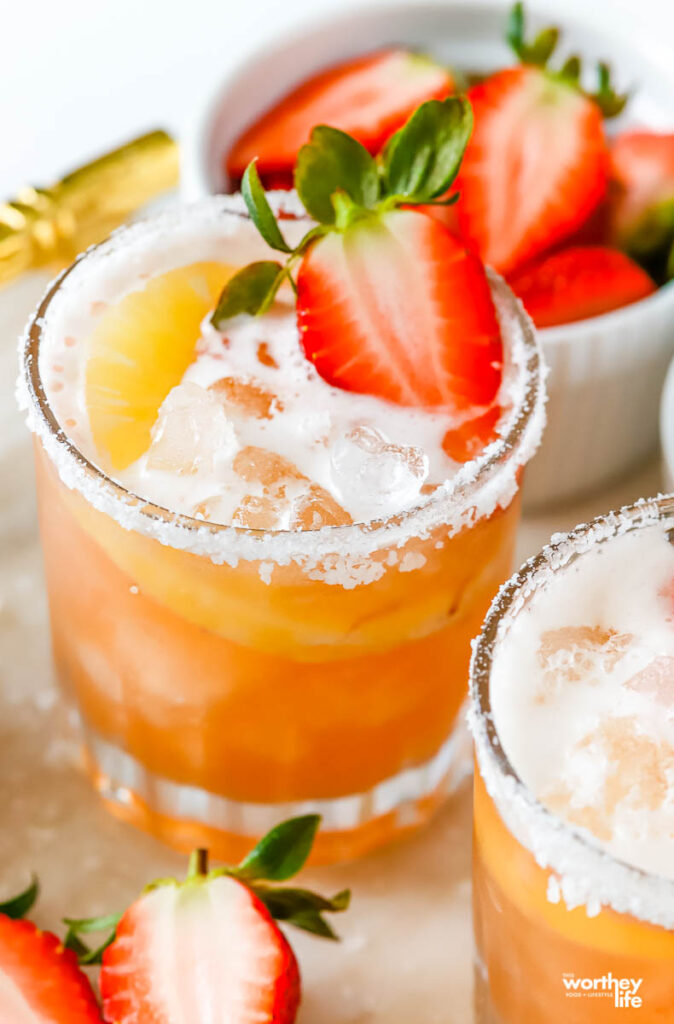 a frosted glass filled with strawberry shrub infused pineapple cocktail