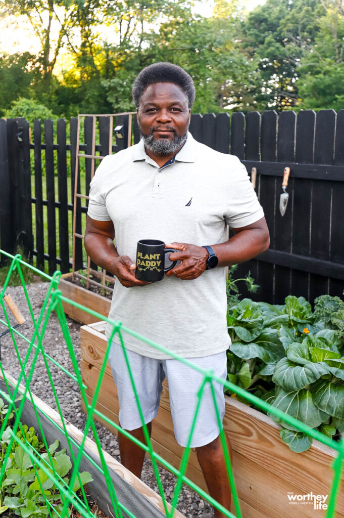 dad in garden with his plant daddy mug
