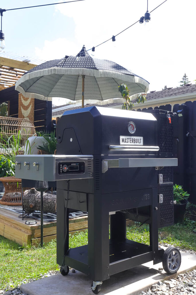 a black grill that is also a griddle and a smoker
