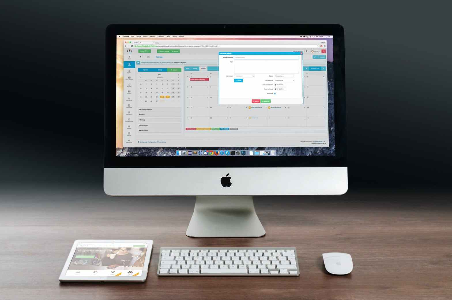 silver imac apple magic keyboard and magic mouse on wooden table