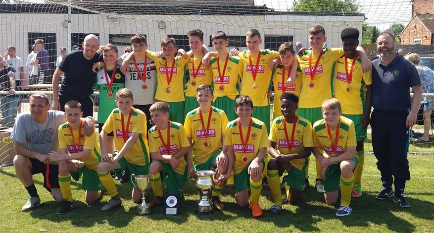 Arden Forest football team players posing in their green and yellow football kit.