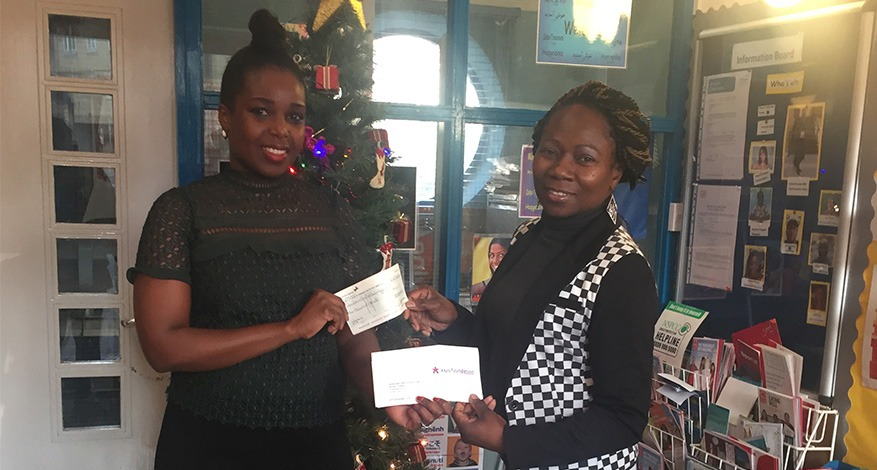 Co-ordinator of Camberwell After School Project receiving cheque.