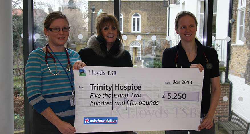 Trustees giving a cheque to the Trinity Hospice.
