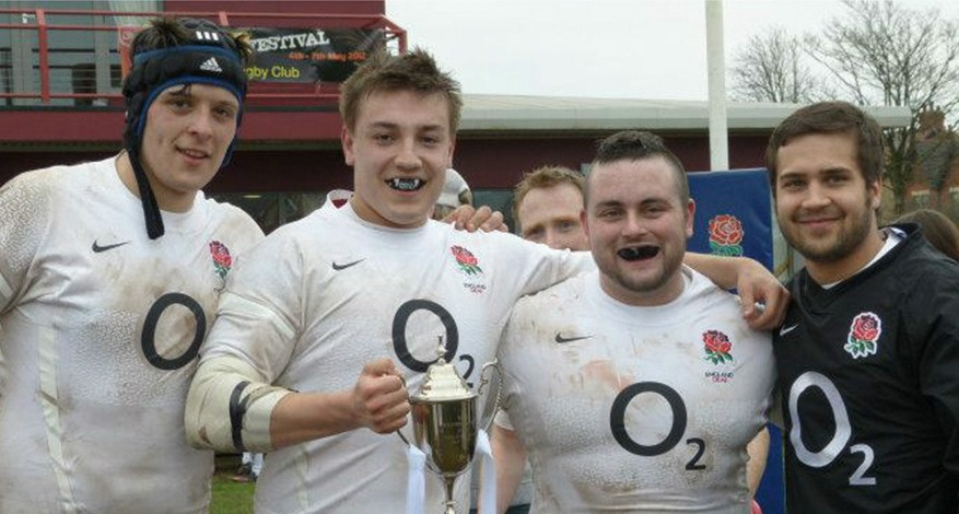 Four men from England Deaf Rugby Team show trophy
