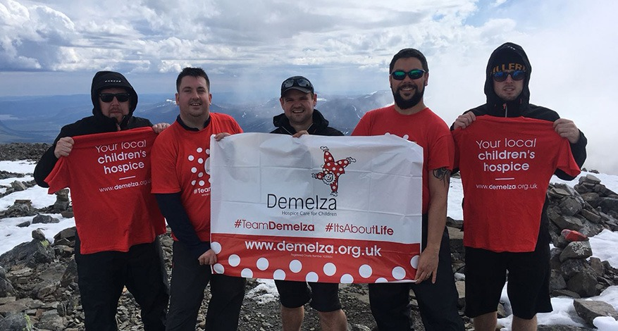 Men on top of Arctic Mountain for Demelza