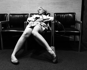 Karolyn Sprawled on a waiting room chair