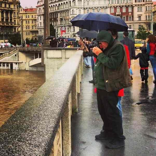 RadkaZimovaK_Man_taking_picture_of_Flooding_Vltava