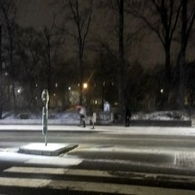 Snowing-city-at-night-pedestrian-crossing