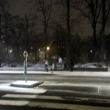 Snowing-city-at-night-pedestrian-crossing