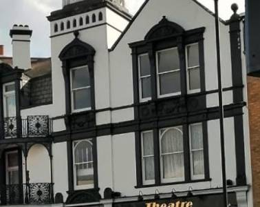 """A tall Tudor style pub building with """"Golden Goose Theatre"""" on the front"""
